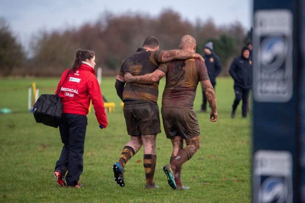 Bannockburn Rugby player Tony Vines helping an injured Morgan player